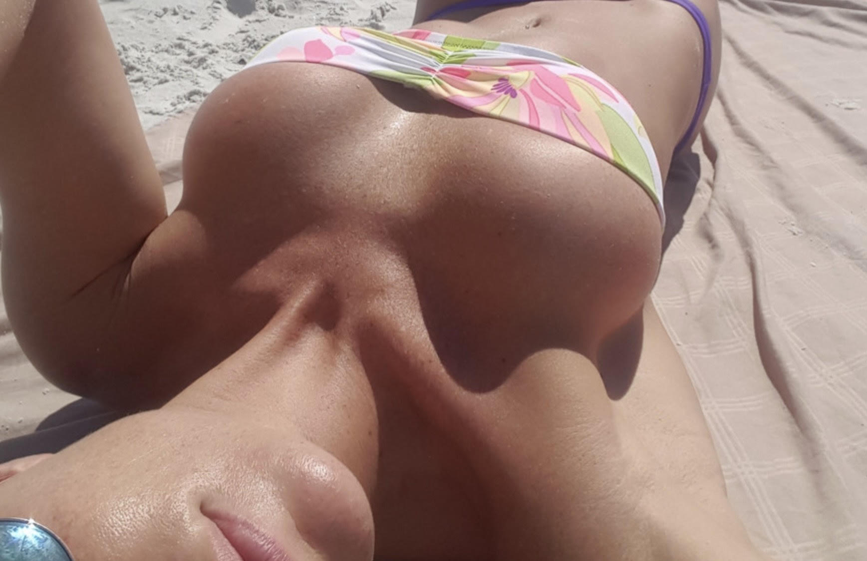 "alt=""Woman sunbathing at the beach with big boobs"">"