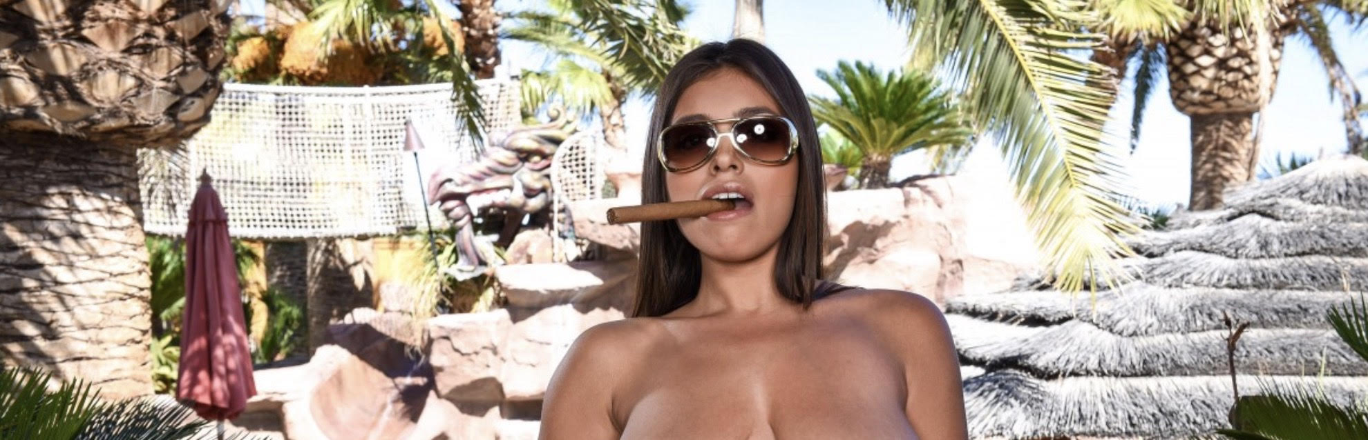 "alt=""Sexy Latina woman wearing sunglasses and smoking a big cigar"">"